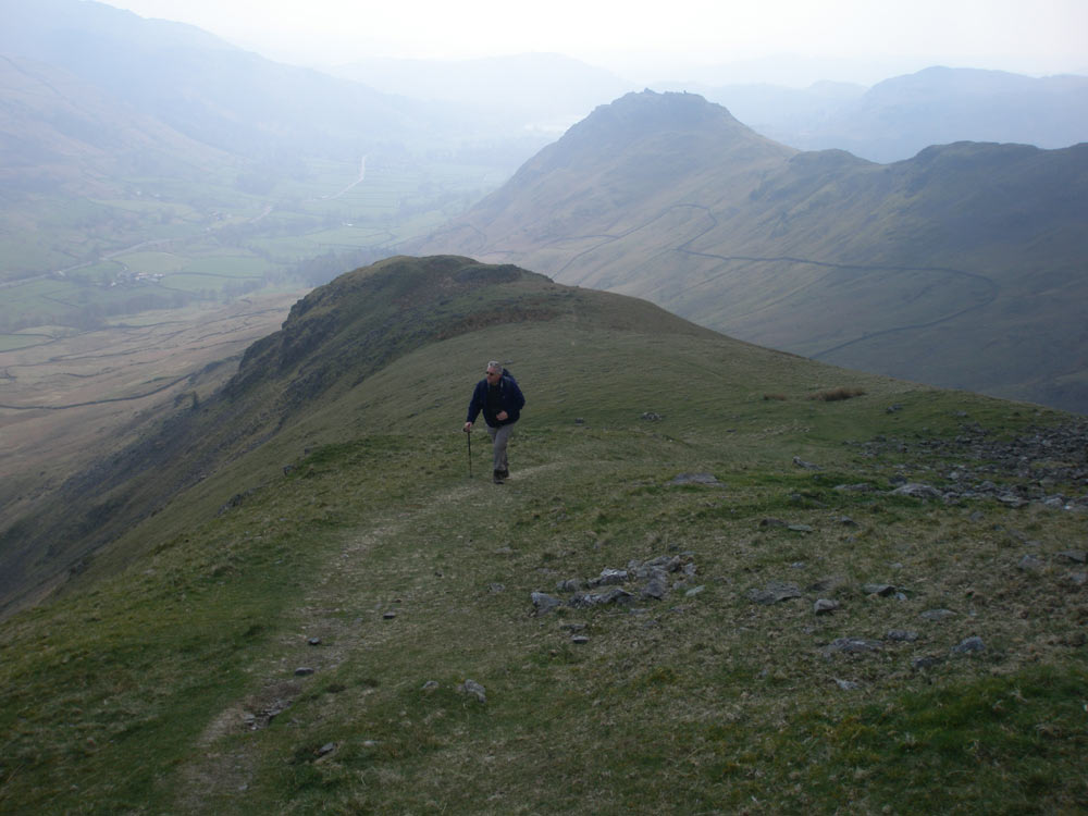 Coming up Steel Fell with Helm Crag behind